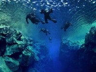 Silfra fissure - A renowned snorkel and diving spot in Iceland. Many travelers who experienced diving between its continental plates says it's very calm and mediative.  This is an underwater adventure that is seldom to surpass.